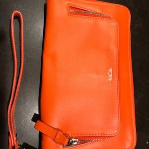Orange tumi wallet